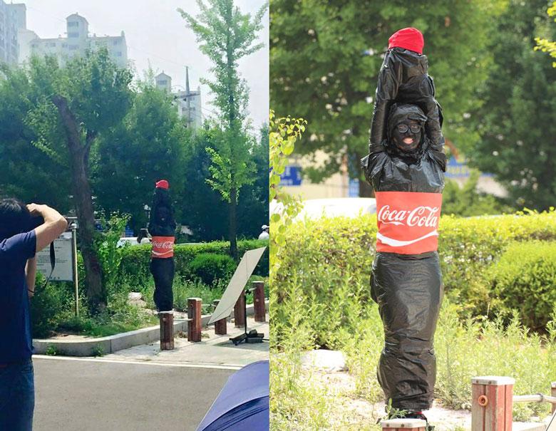 特大瓶可樂 (覺得扮的人肯定很後悔,因為要一直舉手)
