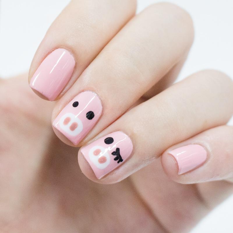 旁邊還有劃上眼睫毛的粉紅小豬如何??