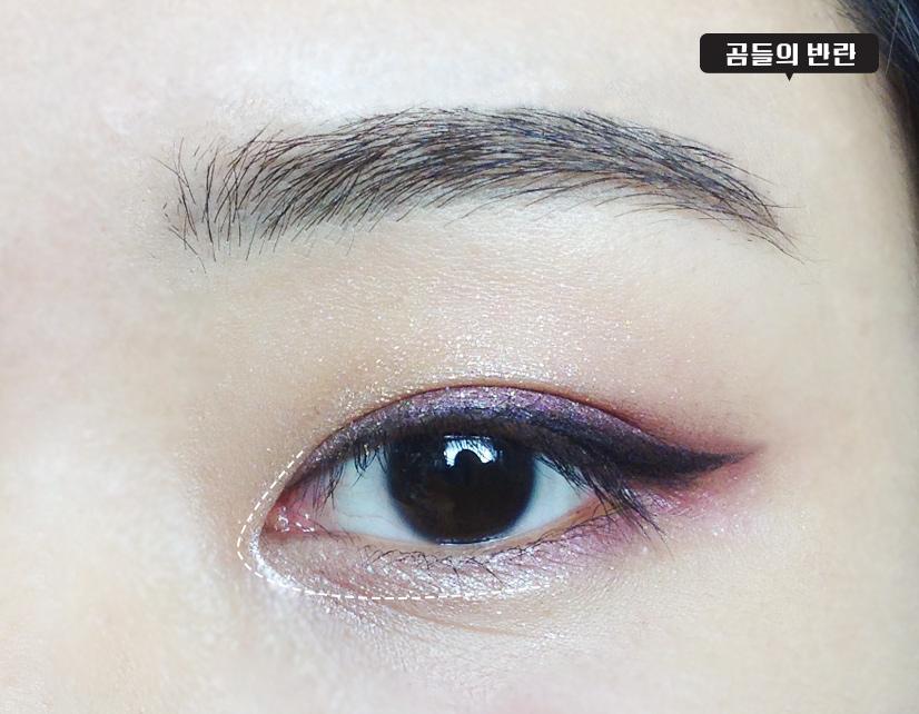 用米色眼影畫一下前眼角
