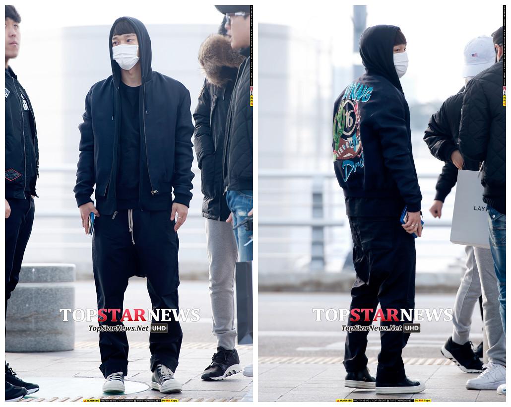 Chen走的是嘻哈風,飛行外套+連帽T+吊襠褲,加上可愛的齊劉海,反而意外的和諧,外套背後的圖案設計讓這身全黑LOOK不至於太無聊。