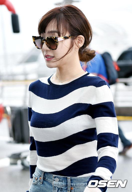 攝影大哥當然是做好準備,快點來記錄一下Tiffany的「機場時尚」!