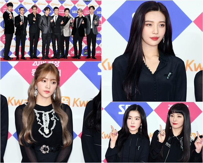 """而在前天的《SBS歌謠大戰》紅毯上,SM旗下的藝人也紛紛穿上了黑色以及深色的服裝,並都在胸口別上了黑色的絲帶,絲帶上也用SHINee的公式色""""湖水綠""""繡著「R.I.P. JH」,以這樣的方式來悼念鐘鉉,也讓粉絲覺得很感動。 不過看到他們努力露出笑容的模樣,也讓人感到很心疼啊..."""