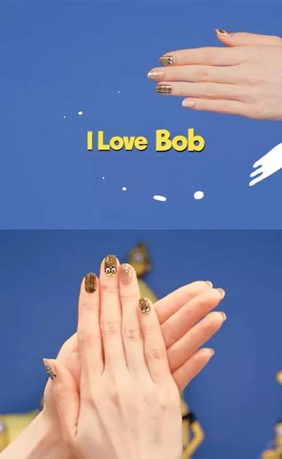 I love Bob(小兵語:我愛Bob)  小小兵也想穿大衣!以卡奇為主色,搭上秋季格紋、金亮片的元素,有點成熟但又有點不想長大的微叛逆感,充滿秋季mood的小兵指彩就選這款了!